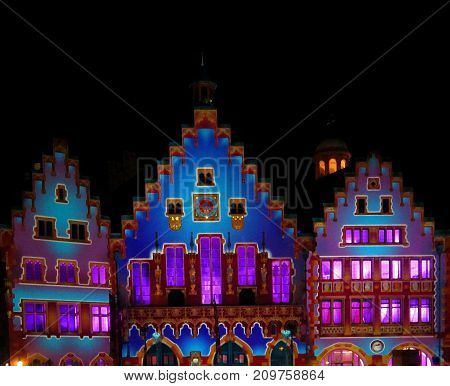 Light Event in Frankfurt (Main), the historical city building Roemer in the night.