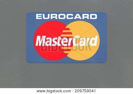 Hvide Sande, Denmark - August 1, 2017: Logo of Mastercard on a panel. Mastercard is an American multinational financial services corporation headquartered in the MasterCard International Global