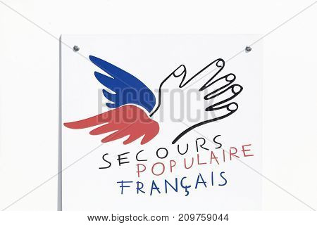 Grenoble, France - June 25, 2017: The Secours Populaire Francais or French Popular Relief, is a French non-profit organization dedicated to fighting poverty and discrimination in public life