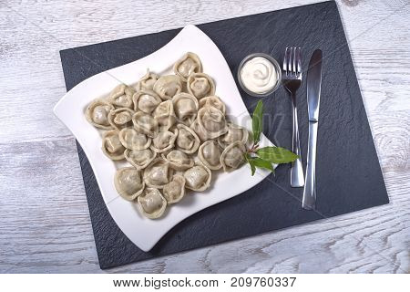 Russian cuisine hot meat dumplings served with herbs