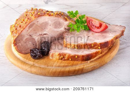 Pork Stew With Prunes On Wooden Plate On White Background