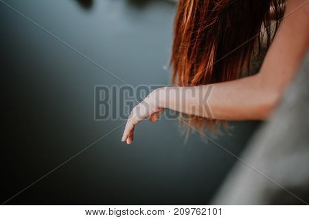 Woman suspending the hand in the air. Sadness concept.