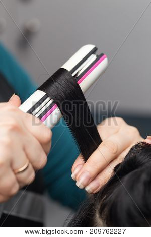 Permanent hair in a beauty salon . photo in the studio