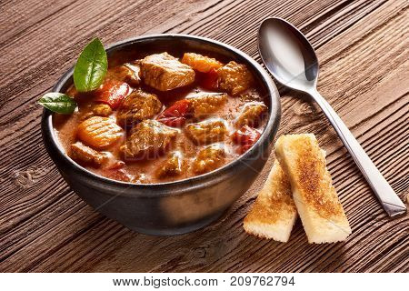Goulash, Beef Stew With Herbs On Wooden Background