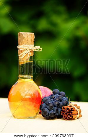 Still Life Of Grapes And Cinnamon On Blurred Background