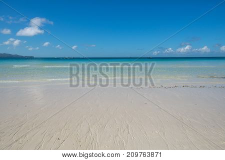 Empty beach with a clear blue sky. Philippines, Malay