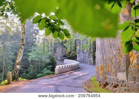 White Historical Crash Barrier On Asphalt Way Leading To Kokorin Village In Kokorinsko Area In Autum