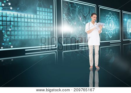 Pretty nurse using 3D tablet pc against screens with blue interface