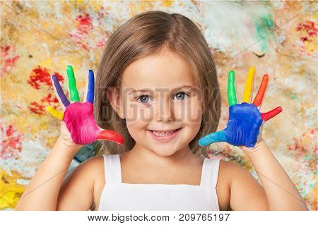 Girl little hands painted showing elementary age cute girl