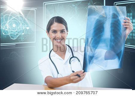 Female doctor examining chest X-ray against composite 3D image of different interface