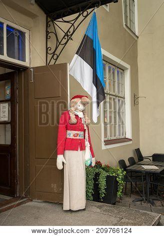 TALLINN, ESTONIA - SEPTEMBER 14: National costume doll above the old town on September 14, 2017 in Tallinn, Estonia. It became a city in 1248.