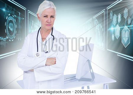 Portrait of confident female doctor standing by desk against composite 3D image of different application interface