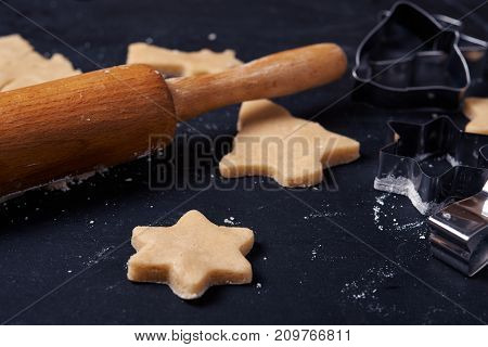 uncooked cookies and rolling pin close up