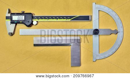 Digital caliper and protractor on paper industrial