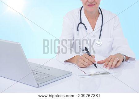 Midsection of female docotor writing prescription at desk against 3D blue vignette background