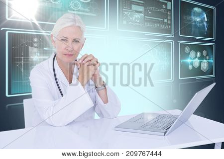 Portrait of confident female doctor with 3D laptop on desk against composite image of different application interface