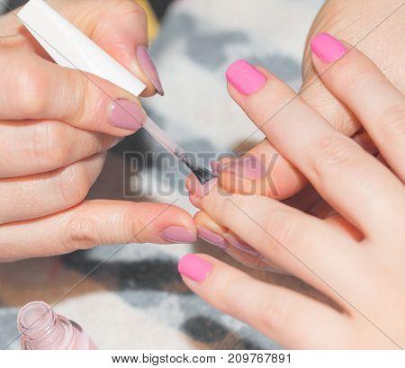 professional manicure in a beauty salon . photo in the studio