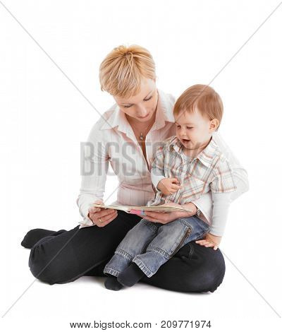 Mother and baby embracing in affectionate moment, reading book.