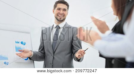 Successful business man at the office leading a group