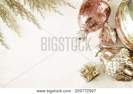 retro glass christmas toys on wooden panel . image in vintage grunge style