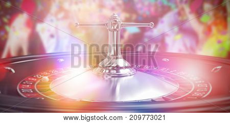 Smiling friends dancing on dance floor against close up image of 3d roulette wheel