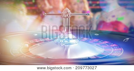 Group of friends posing in bar against close up image of 3d roulette wheel