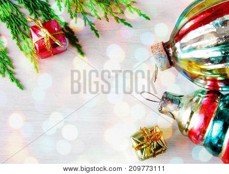 retro glass christmas toys on wooden panel in xmas lights