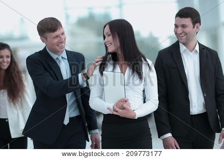 business team : colleagues communicate with each other in the of