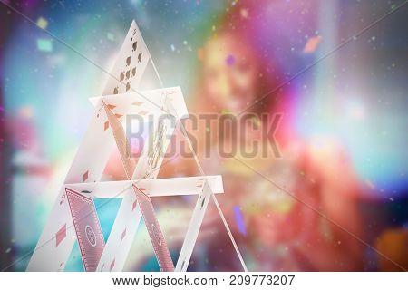 Composite 3D image of portrait of two women having cocktail against 3d image of card castle