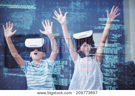 Siblings using virtual reality 3D headset in living room at home