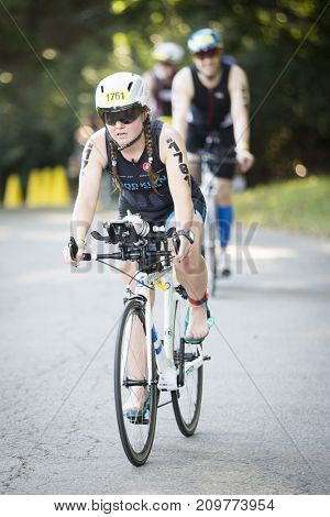 NEW YORK - JUL 16 2017: NYC Triathlon Race, competing athletes bike 40 kilometers including in Riverside Park in Manhattan in the only International Distance triathlon in New York City.