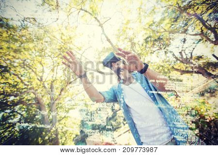 Man using virtual reality 3D glasses in park