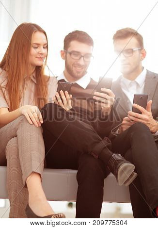 Group of young people use their phones