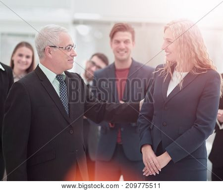 Group of happy colleagues communicating in office