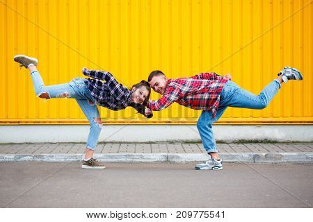 portrait of carefree young couple that dancing on street and smiling, enjoying life