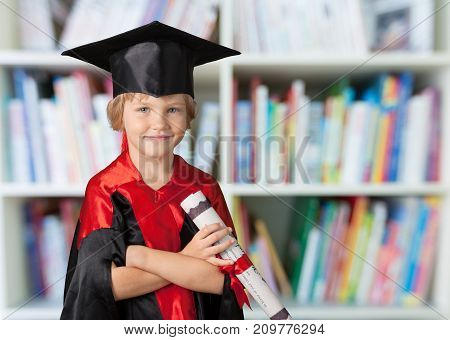 Boy hat diploma graduation red white high