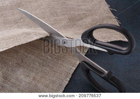 The Tailor's Scissors Cut Linen Cloth.