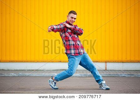 portrait of young man hip hop dancer with grunge wall background texture