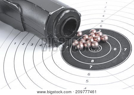 Airgun and bullets on the target background.