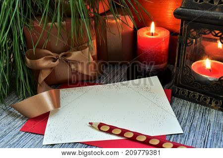 Christmas card, gifts, candles, space for lettering, pine branch.