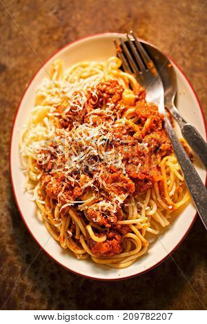 Spaghetti Bolognese with minced beef, tomato sauce, grated parmesan
