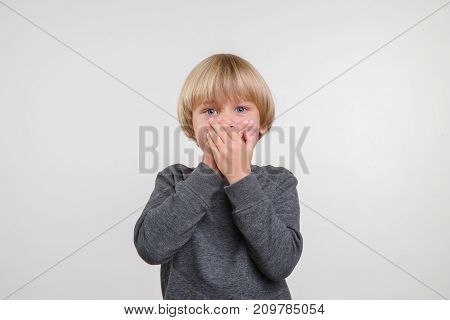 Horisontal emotional cute portrait of caucasian boy. Handsome happy child, white background