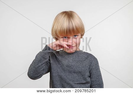 Portrait of handsome happy child, picture on gray background