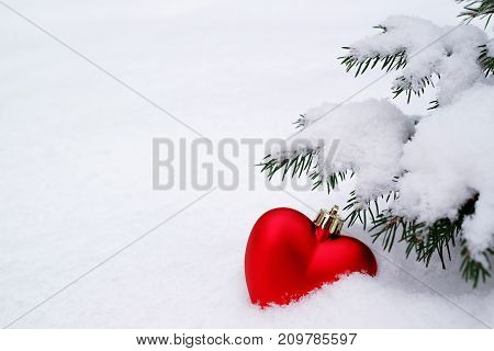 Christmas toy under the Christmas tree heart