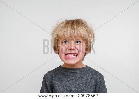Cute horisontal portrait of handsome happy child