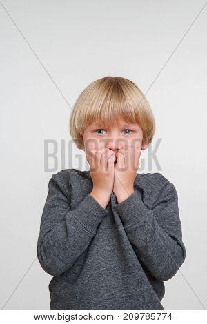 New cute vertical emotional portrait of caucasian boy