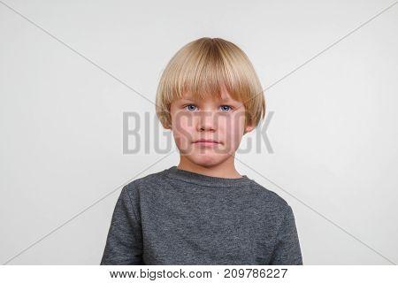 Fine horisontal photo of handsome happy caucasian child