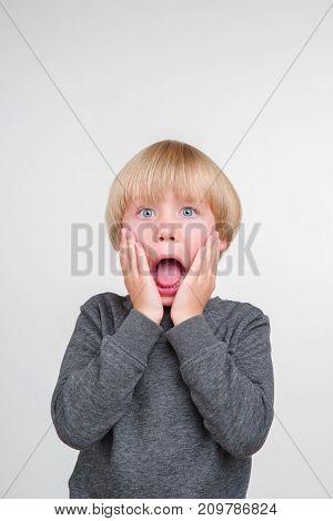 Emotional portrait of caucasian boy isolated on white background