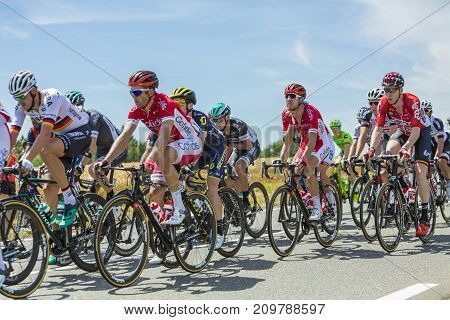 Mailleroncourt-Saint-Pancras France - July 5 2017: Nicolas Edet of Cofidis Team and Marcel Sieberg of Lotto-Soudal Team riding in the peloton on a road to La Planche des Belle Filles during the stage 5 of Tour de France 2017.