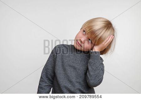 Horisontal portrait of caucasian boy. Handsome happy child, photo on grey background